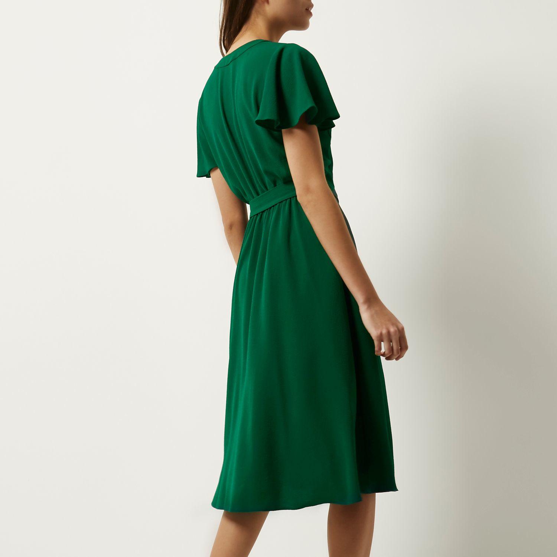 River Island Dark Green D Ring Wrap Midi Dress In Blue Lyst Jolie Clothing Neil Polka