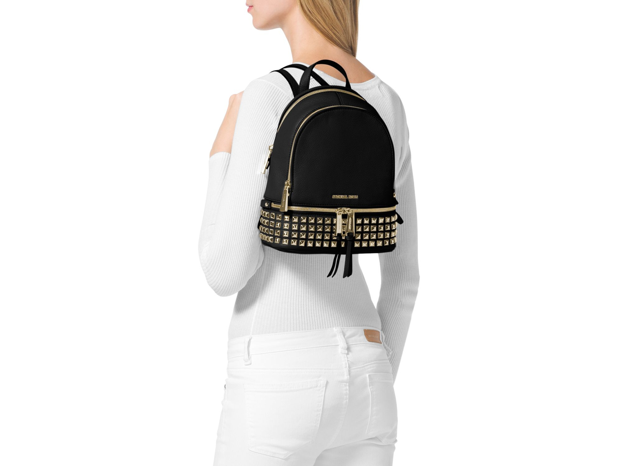 bb5146556f9a best price mini backpack leather michael kors fe6b5 1f866  usa lyst michael  michael kors extra small rhea zip studded backpack in c711f a81e3