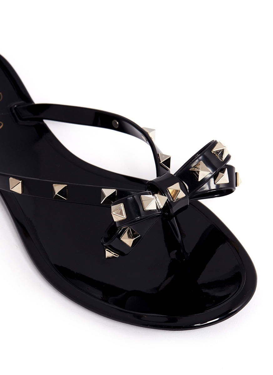 0b245e1b61a Lyst - Valentino Rockstud Bow Flat Jelly Sandals in Black