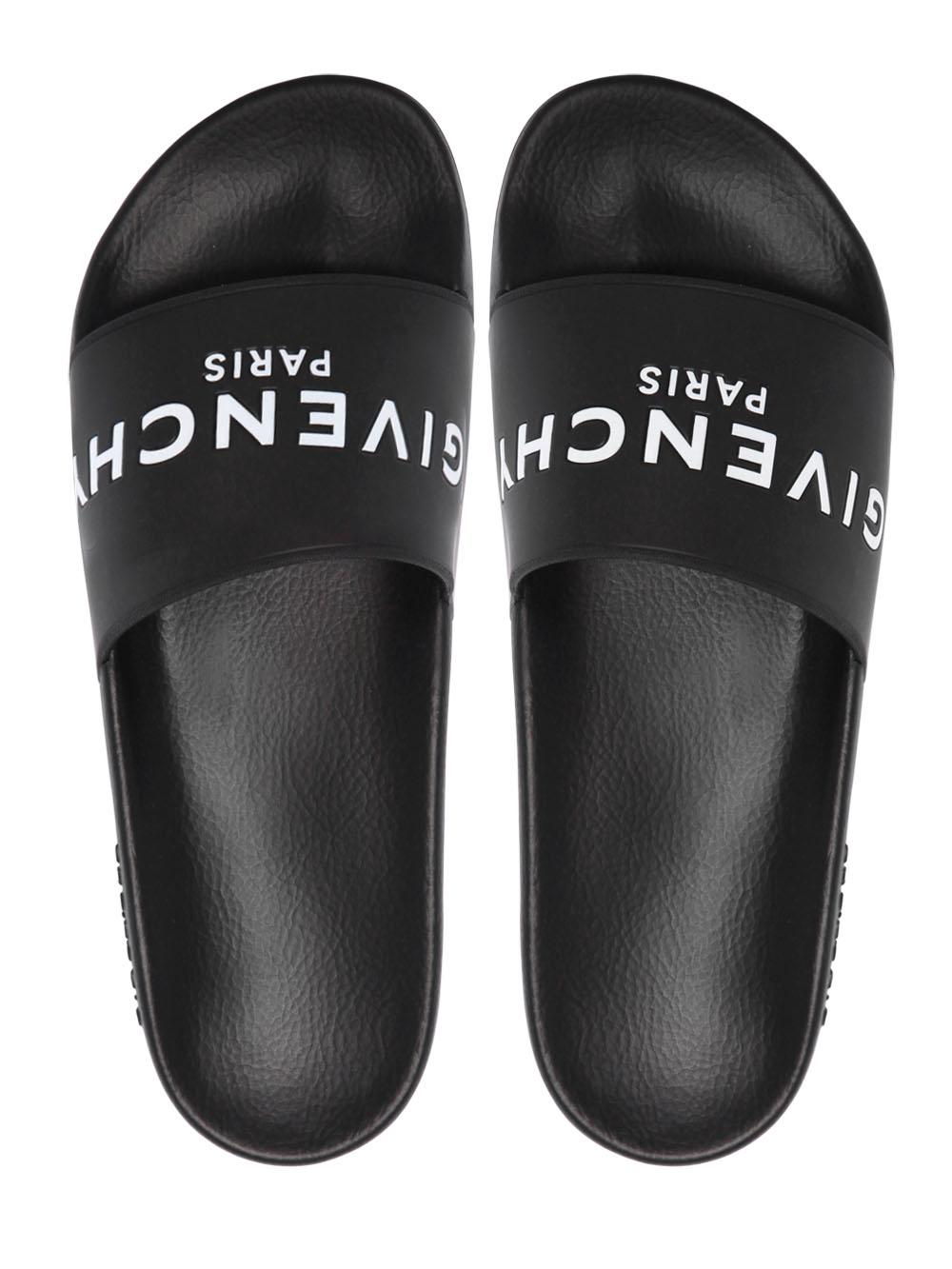 a75a6ecc57c Lyst - Givenchy Logo Rubber Slide Sandals in Black for Men