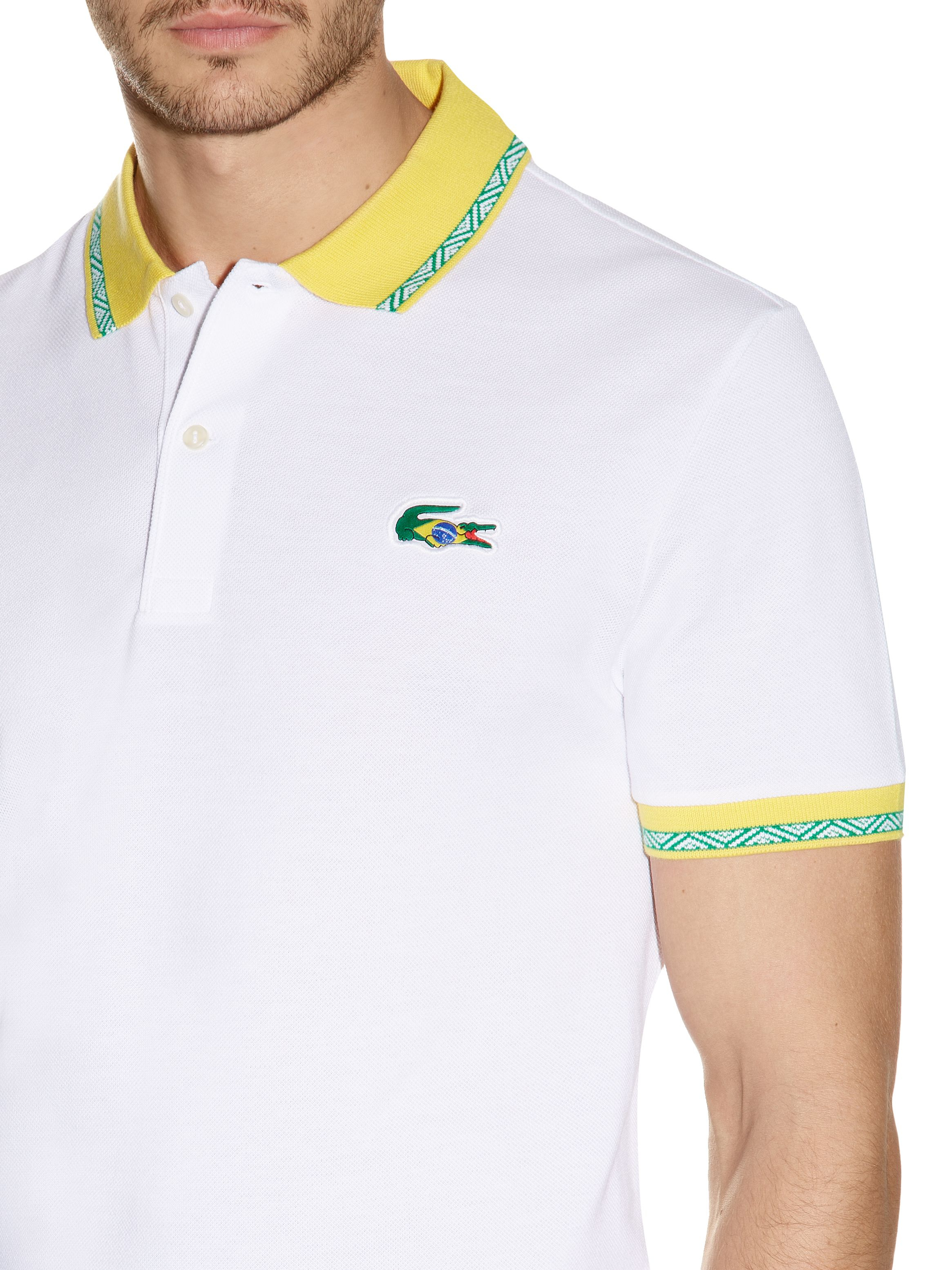 Lyst lacoste brazil themed polo shirt in white for men for Man in polo shirt