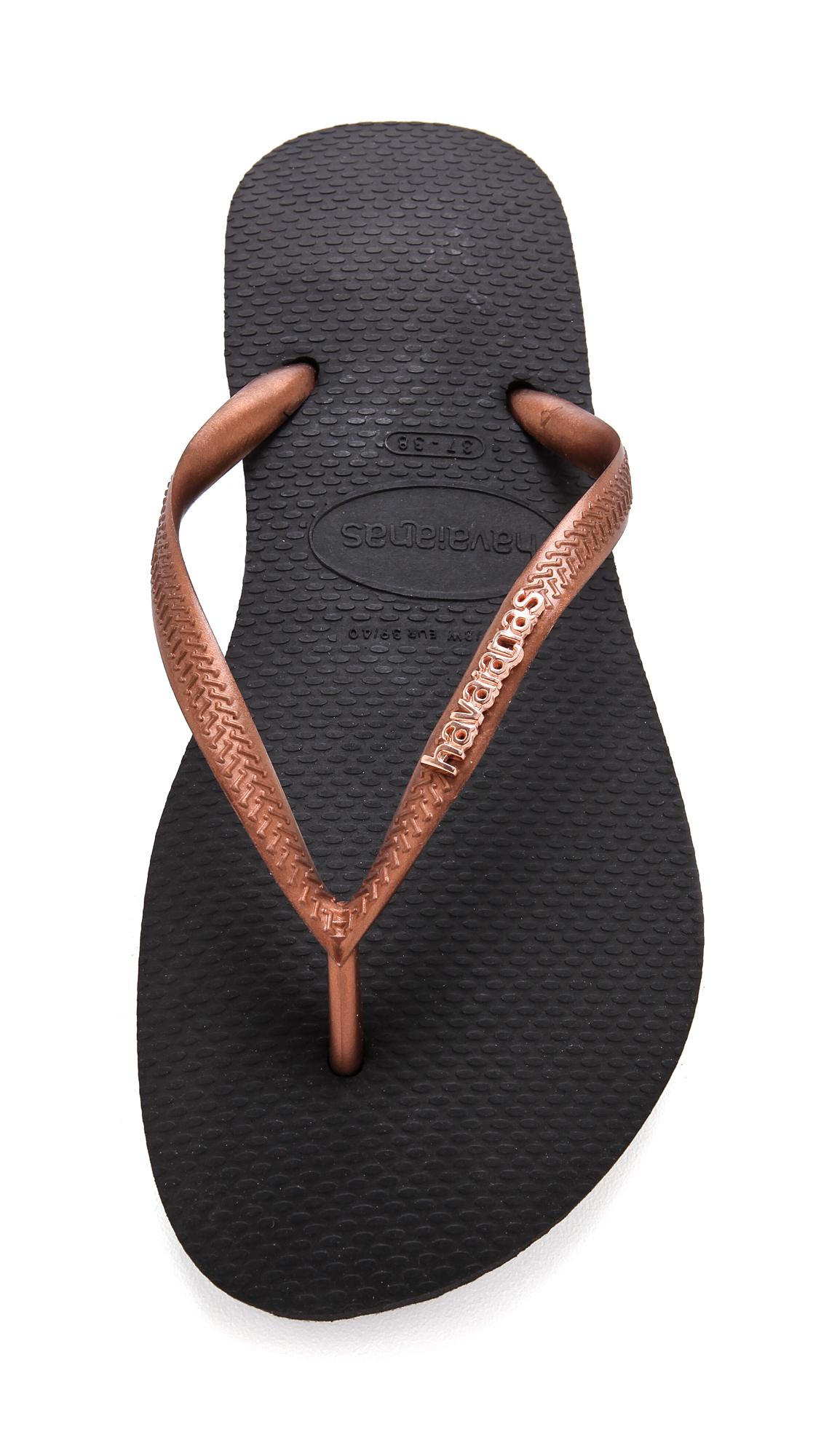 e419b4d337608 Lyst - Havaianas Slim Logo Metallic Flip Flops - Black copper in Black