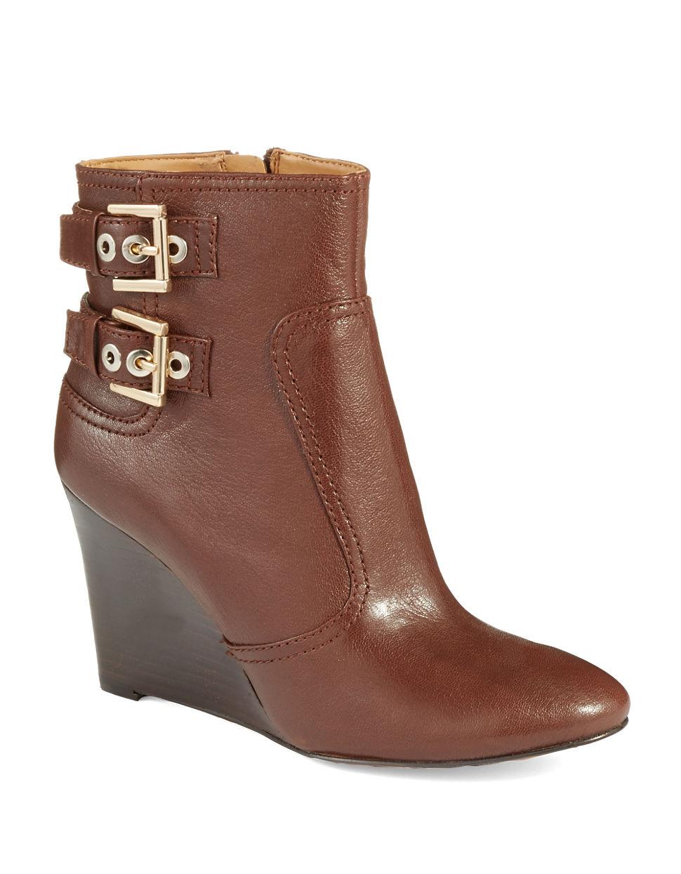 nine west herbert wedge boots in brown lyst
