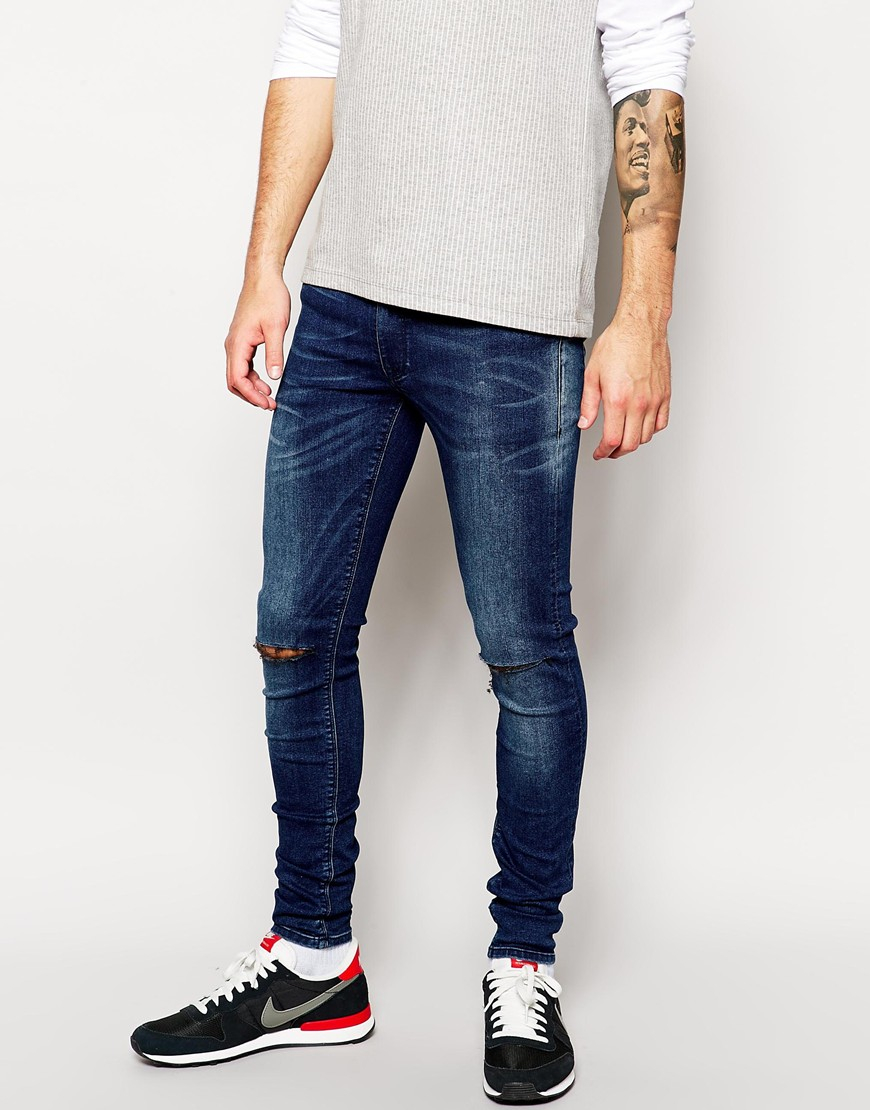asos extreme super skinny with knee rips in mid blue wash in blue for. Black Bedroom Furniture Sets. Home Design Ideas