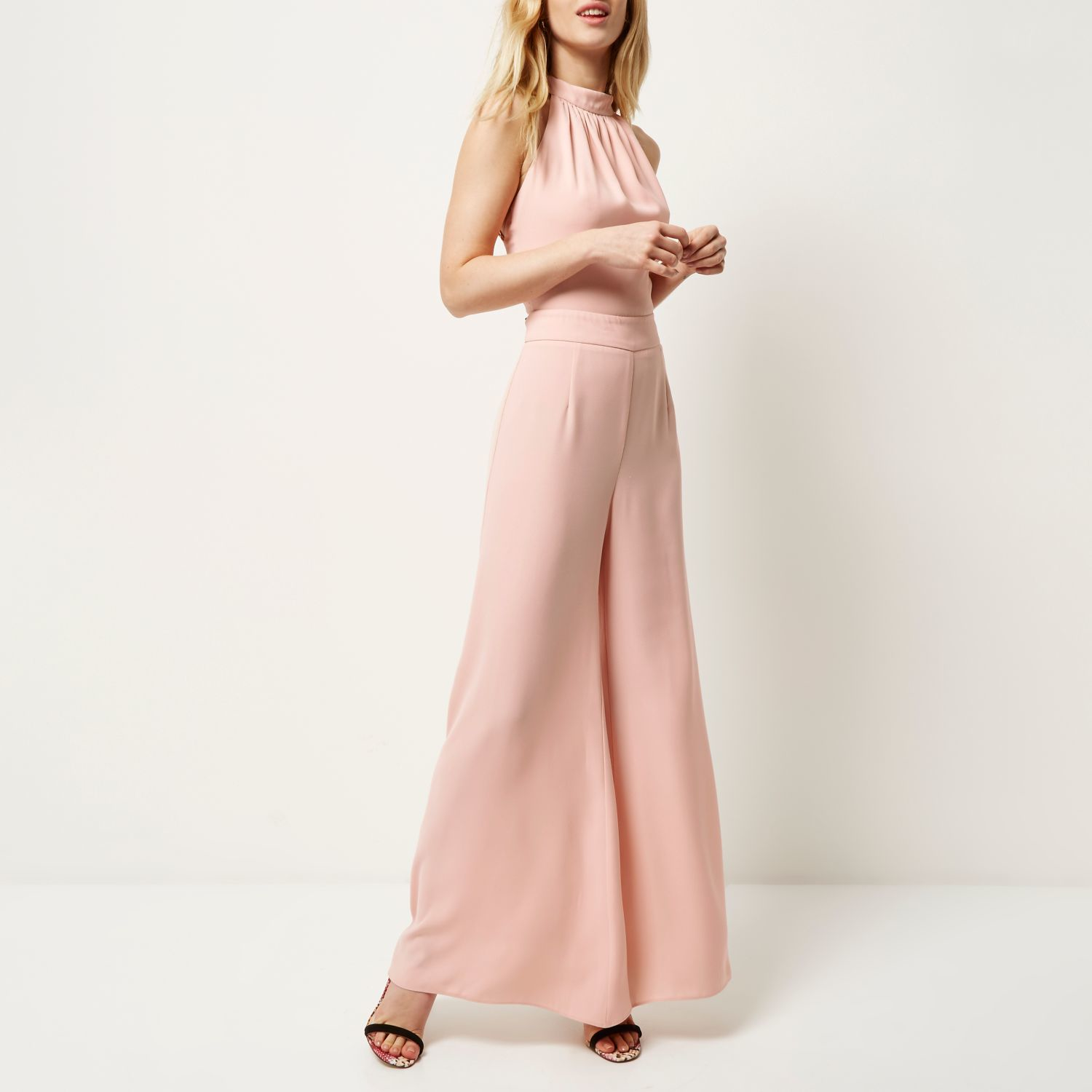 a1100d67598e Lyst - River Island Pink Halter Neck Wide Leg Jumpsuit in Pink