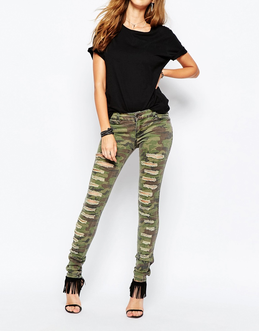 Tripp Nyc Low Rise Skinny Jeans With All Over Rips In Camo Print in