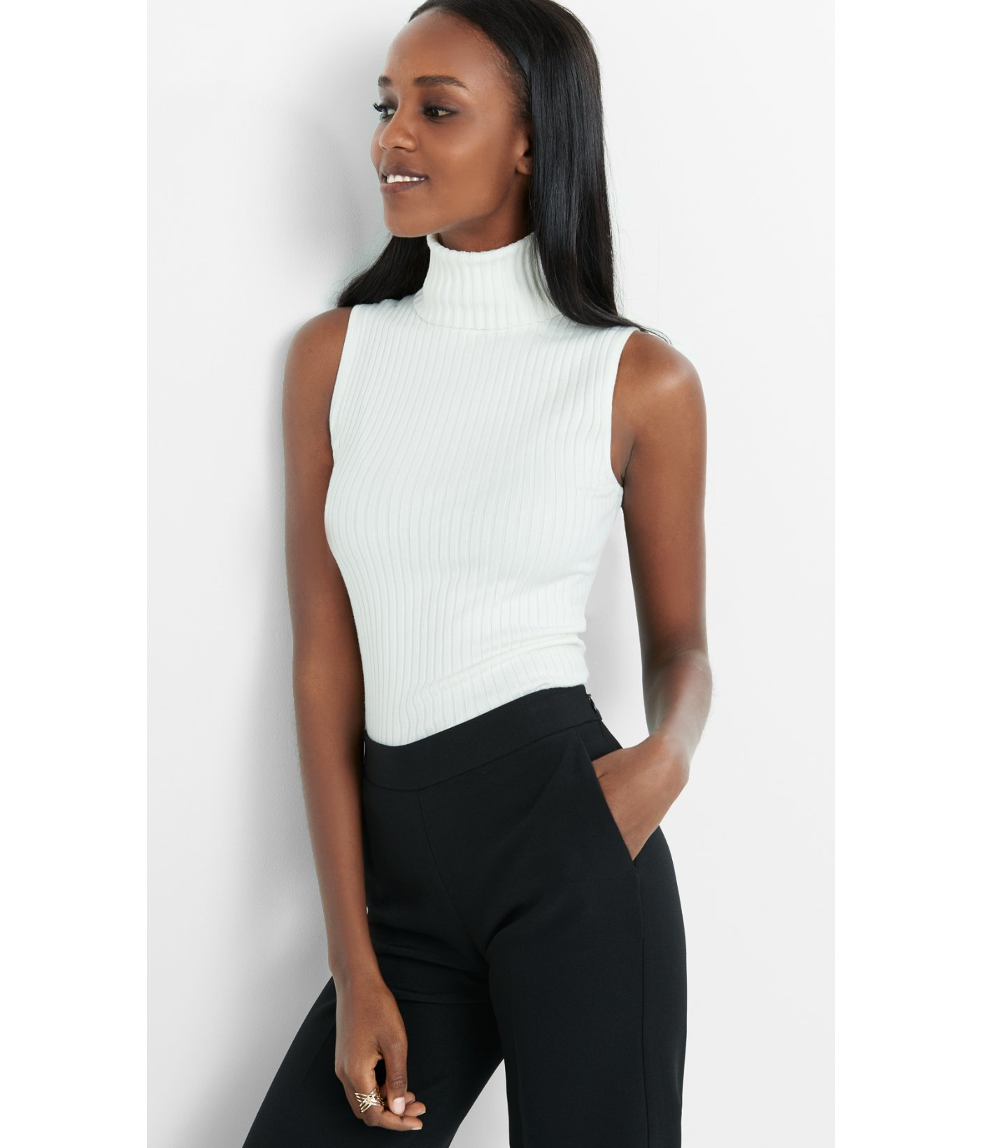 feab1b7bfdea Lyst - Express Sleeveless Ribbed Turtleneck Sweater in White