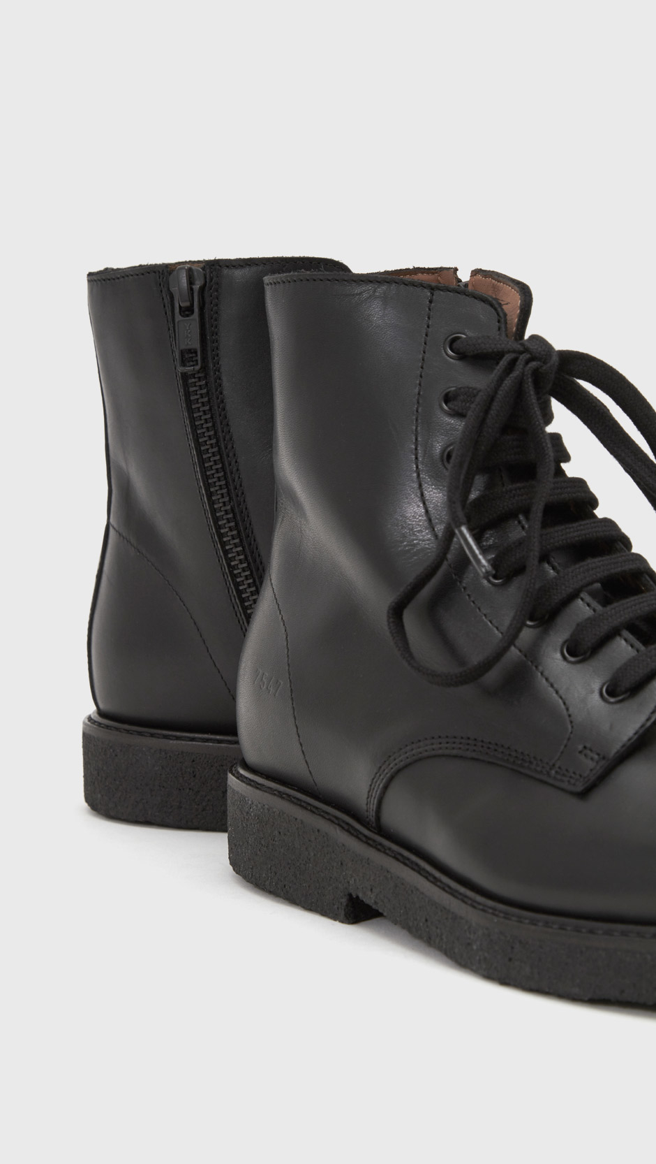 491e59d23ed00 Lyst - Common Projects Combat Boots in Black