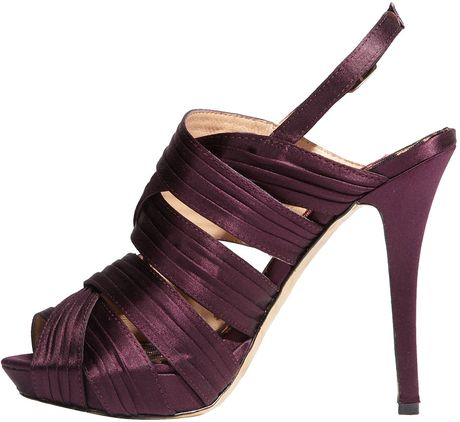 https://cdnc.lystit.com/photos/2010/12/23/betsey-johnson-purple-satin-eden-sandal-purple-product-3-171497-504924216_large_flex.jpeg