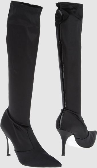 High heeled Boots.