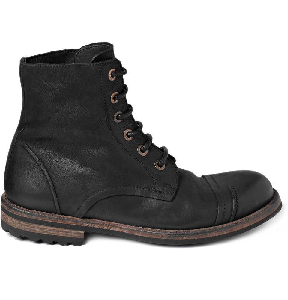 dolce gabbana vintage effect leather boots in black for