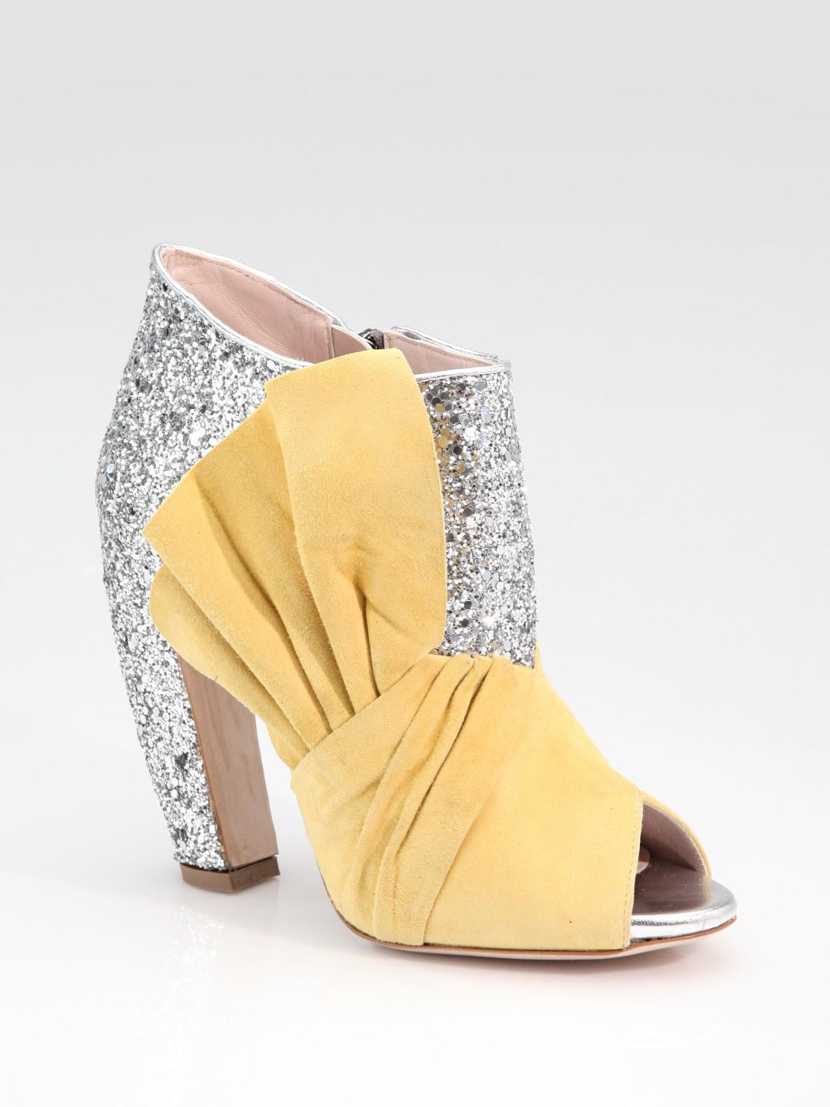c7bb6f04475b Lyst - Miu Miu Glitter   Suede Bow Peep Toe Ankle Boots in Yellow