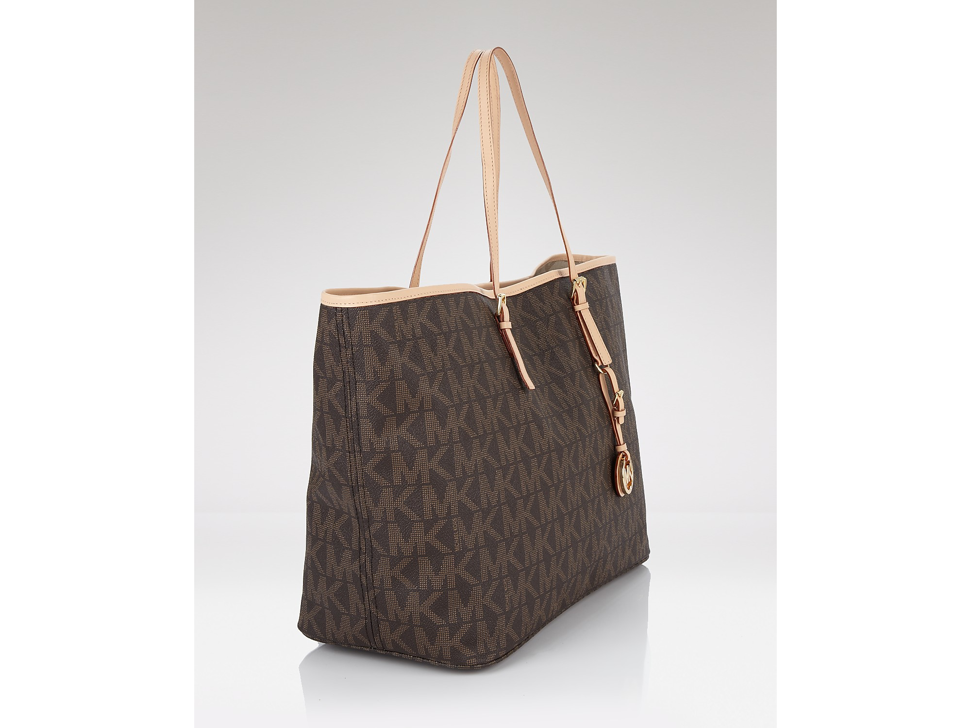 1dfb59b13a8d Lyst - Michael Kors Jet Set Logo Effect Travel Tote in Brown