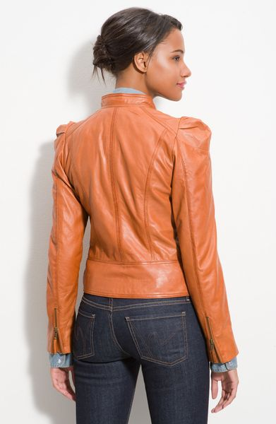 Puff Shoulder Jacket - Give cold-weather style serious edge with this bebe moto jacket, featuring asymmetric metal zipper detailing, cropped style and body-contouring seam. Bonus: Comes in hot red.5/5(1).