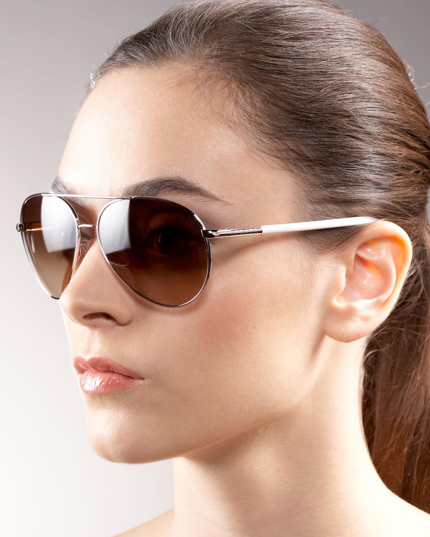 585dc4722c3 Lyst - Prada Aviator Sunglasses in Metallic