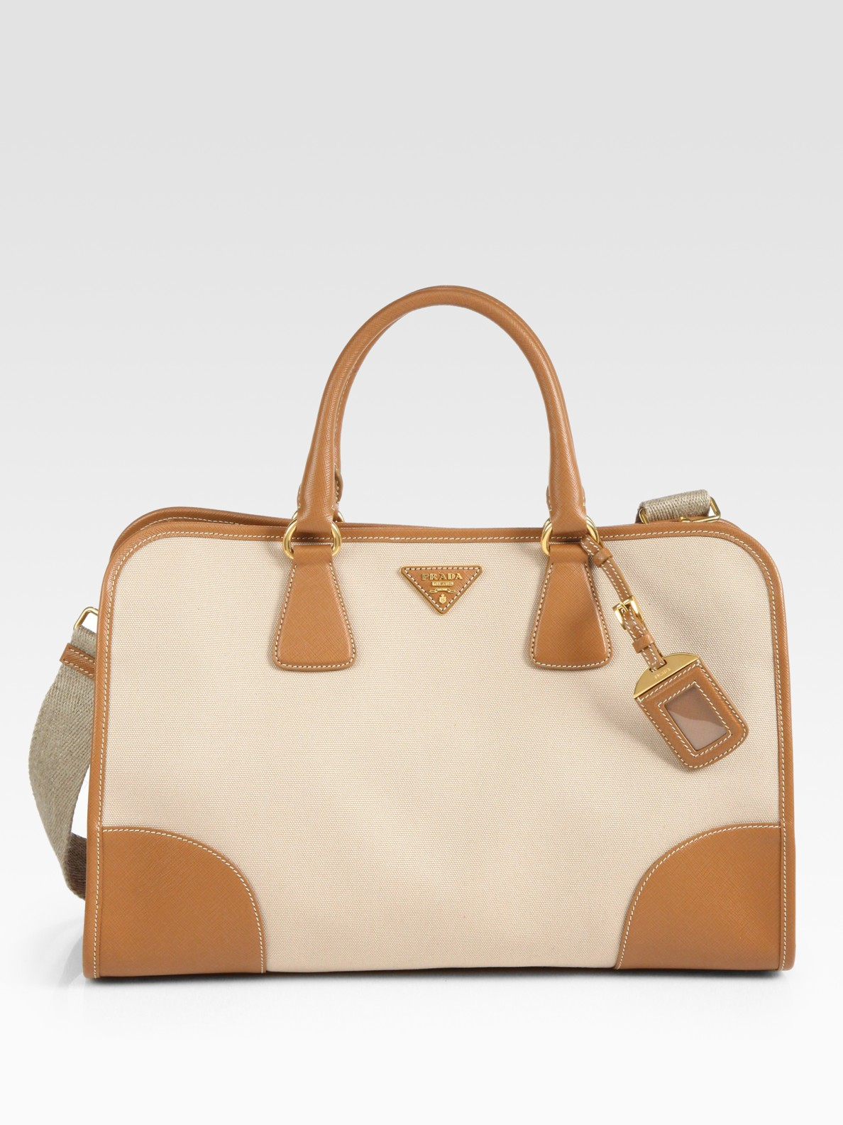 f8da7758f9d5f4 ... official lyst prada saffiano leather canvas top handle bag in natural  bbb91 b94b6