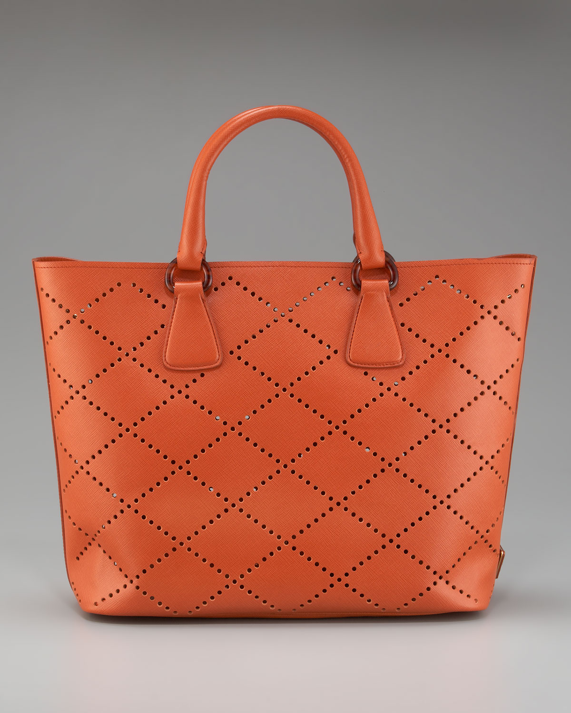 b65bea541881 Prada Saffiano Fori Perforated Tote in Orange - Lyst