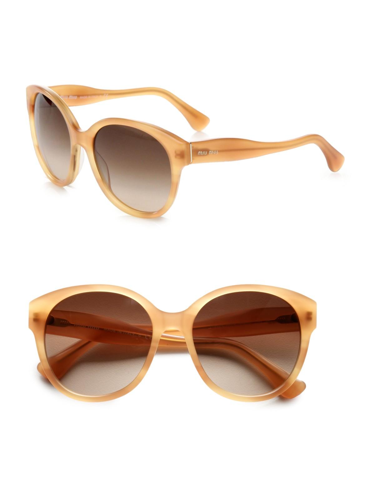 fd3492dd4be Lyst - Miu miu Round Plastic Sunglasses in Brown