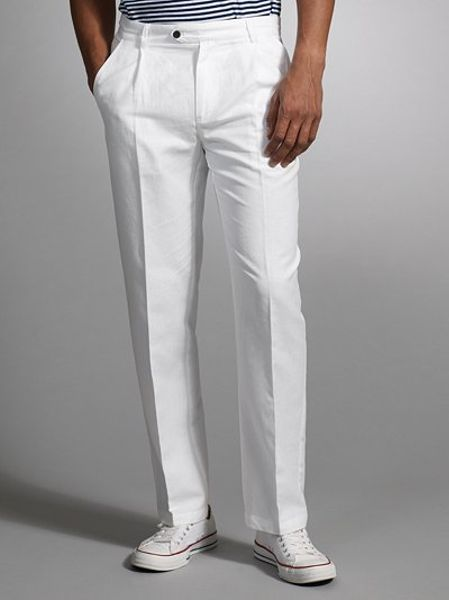 Women's linen trousers are a true warm-weather staple. Choose a wide-legged design for a breezy feel, or opt for a tapered, ankle-grazer style for Parisian chic. Clash textures and pair high-waisted trousers with a fitted silk shirt for a work-appropriate ensemble, or team a cropped style with sandals and a Breton top for the weekend.
