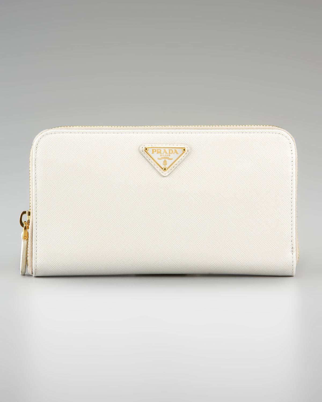608985193e ... promo code for lyst prada saffiano ziparound wallet in white cca20 94796