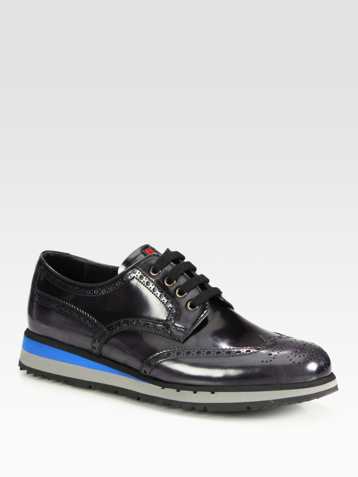 prada wingtip platform sneakers in black for asphalt