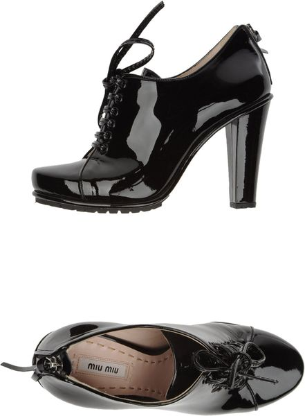 Miu Miu Laced Shoes in Black