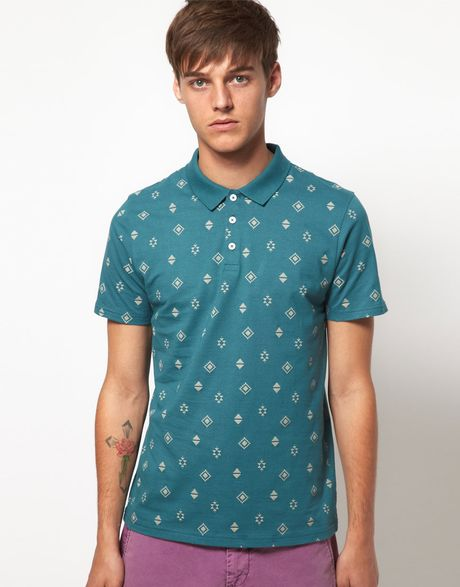 Asos asos polo shirt with all over print in blue for men for Mens teal polo shirt