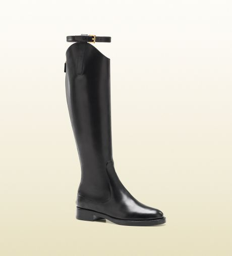 gucci equestrian flat leather boot in