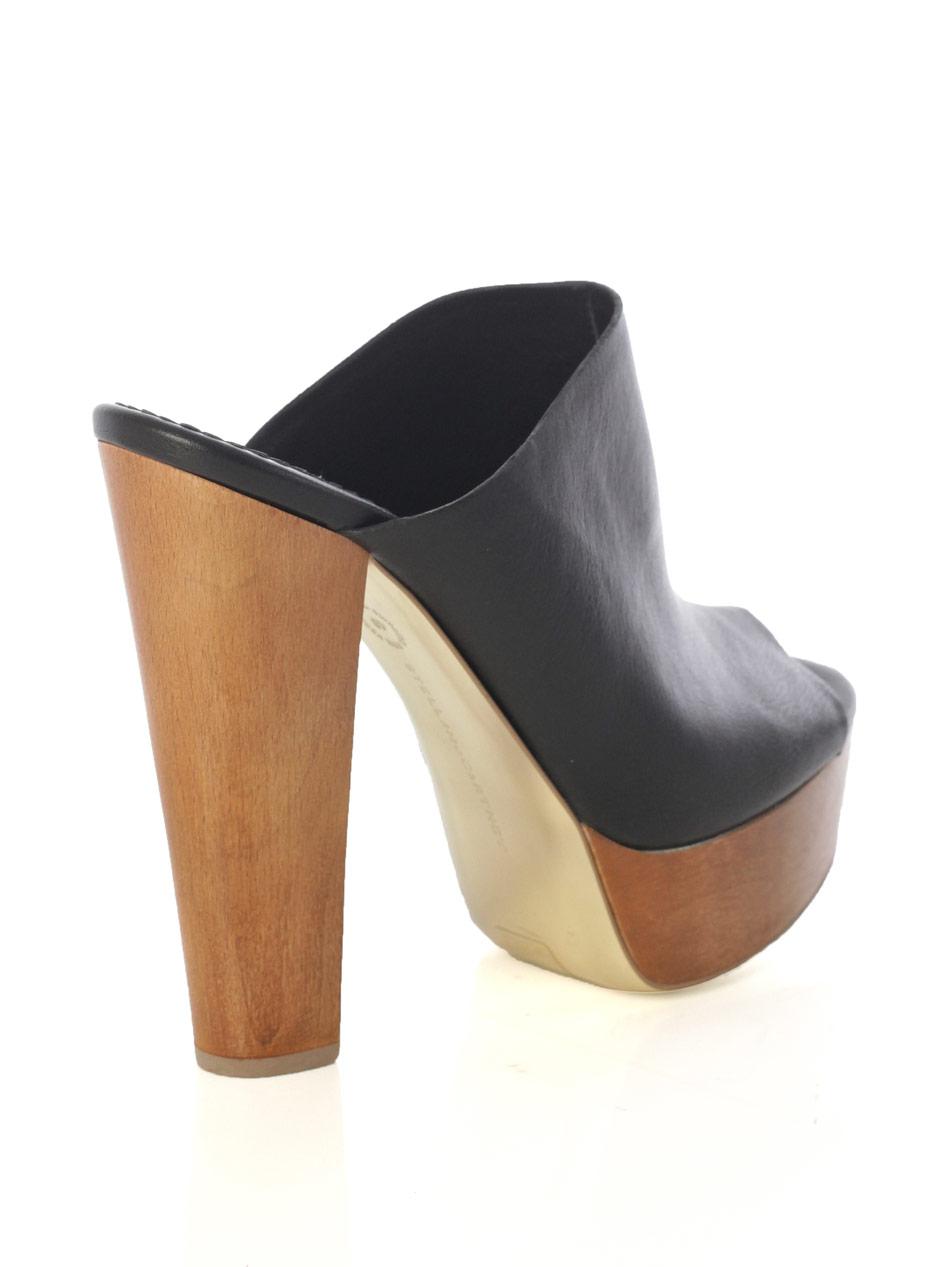 stella mccartney harris mule shoes in black lyst
