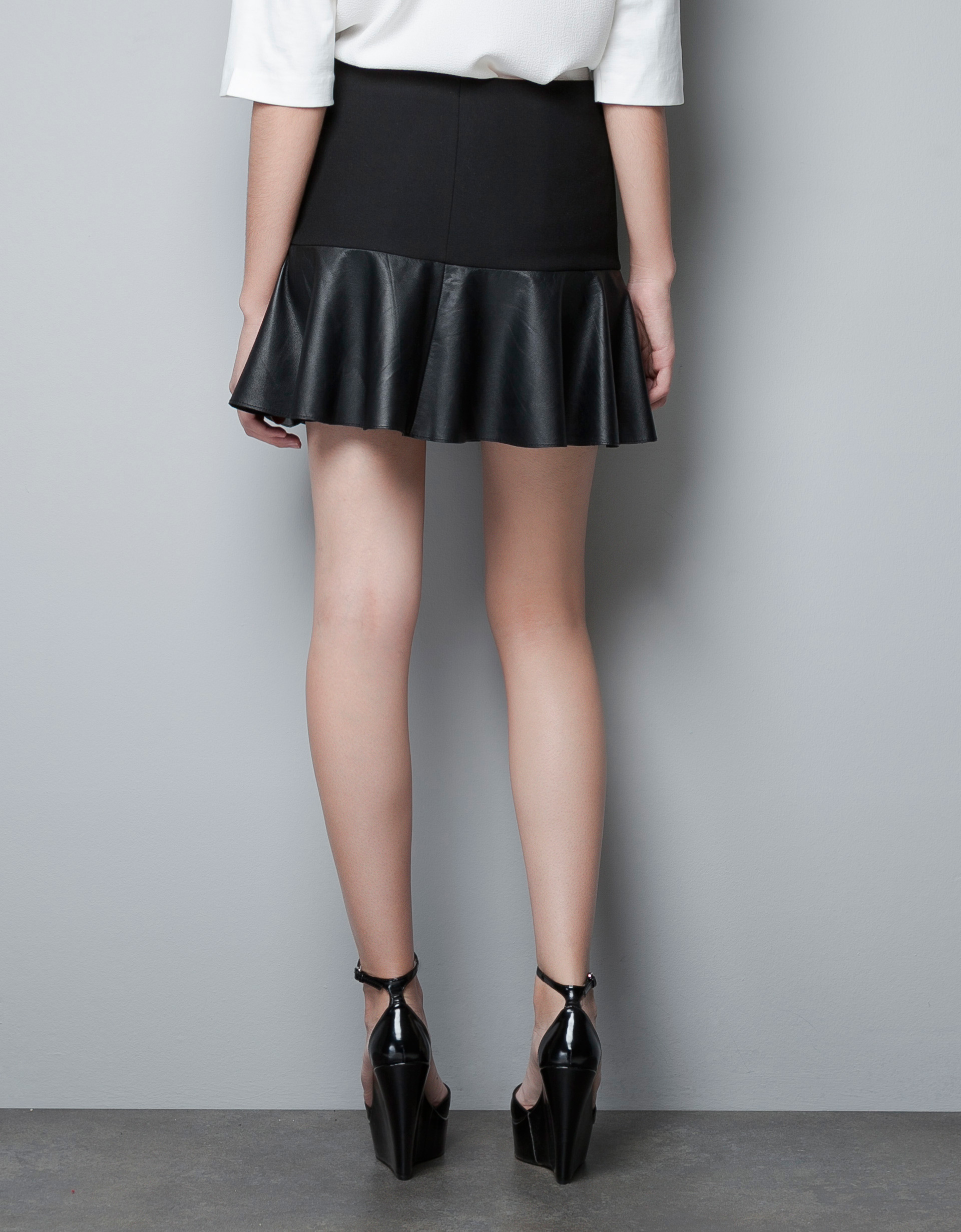 Zara Mini Skirt with Leather Frill in Black | Lyst