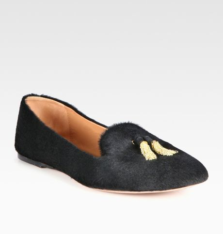 The Bearpaw Shae Solids Smoking Slipper adds polish to the traditional indoor slipper with its chic silhouette and pom-pom accent. Unstructured smoking slipper in Price: $