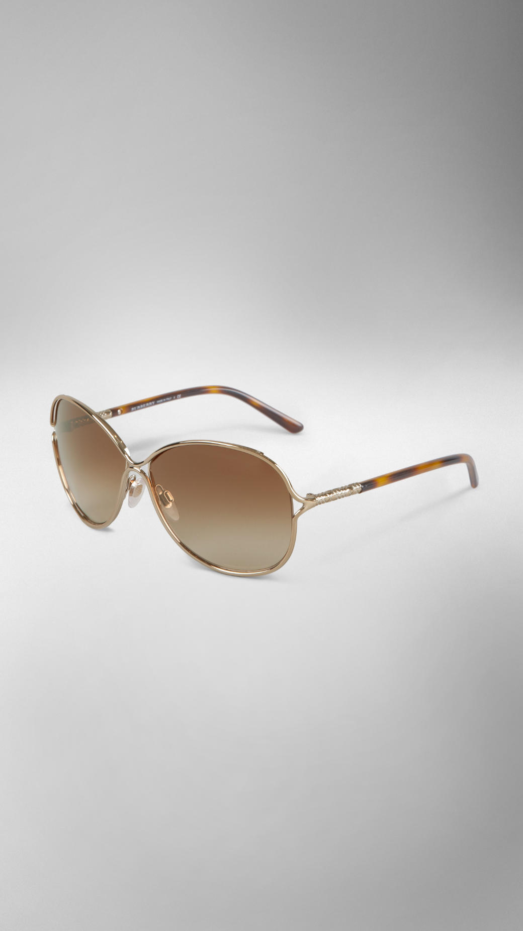 c4039d3ed2e8 Lyst - Burberry Metal Round Frame Sunglasses in Metallic