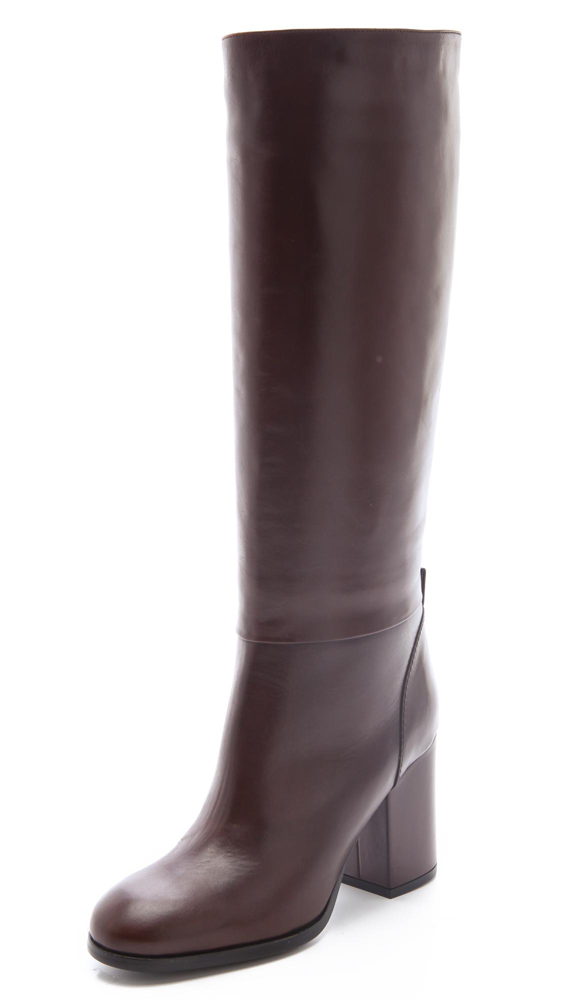jil sander navy knee high heeled boots in brown lyst