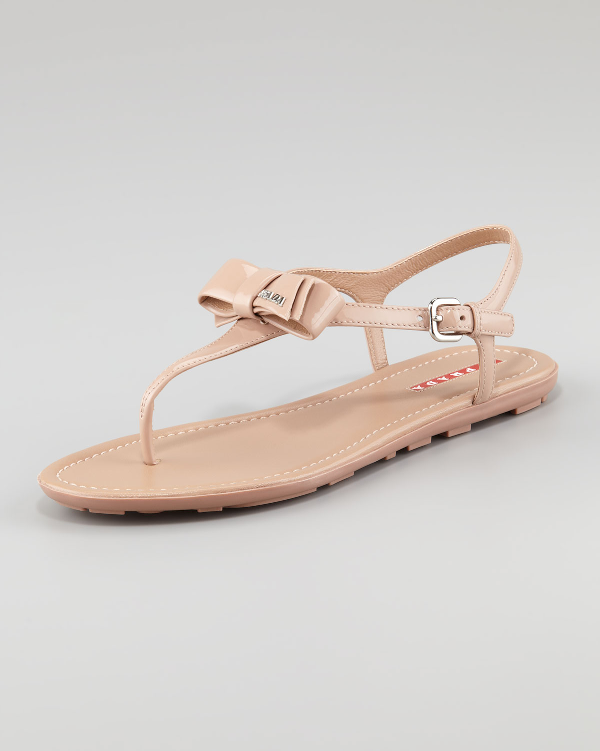 978e23f5df725f Lyst - Prada Patent Leather Bow Thong Sandal in Natural