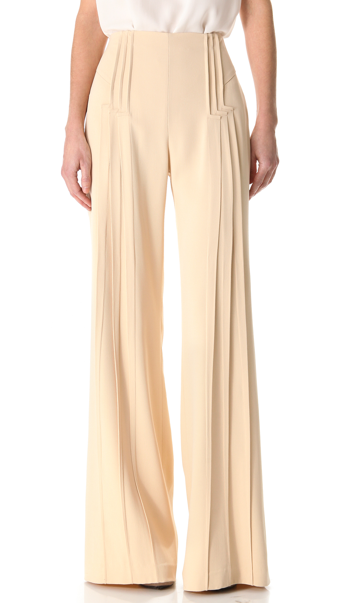 Typically, slim pants for women measure 10 to 14 inches around the ankle, while wide-leg pants go up to 20 inches. The flared or bell bottom style, usually with a fitted cut through the thigh, rounds out at the ankle at 21 inches or more.