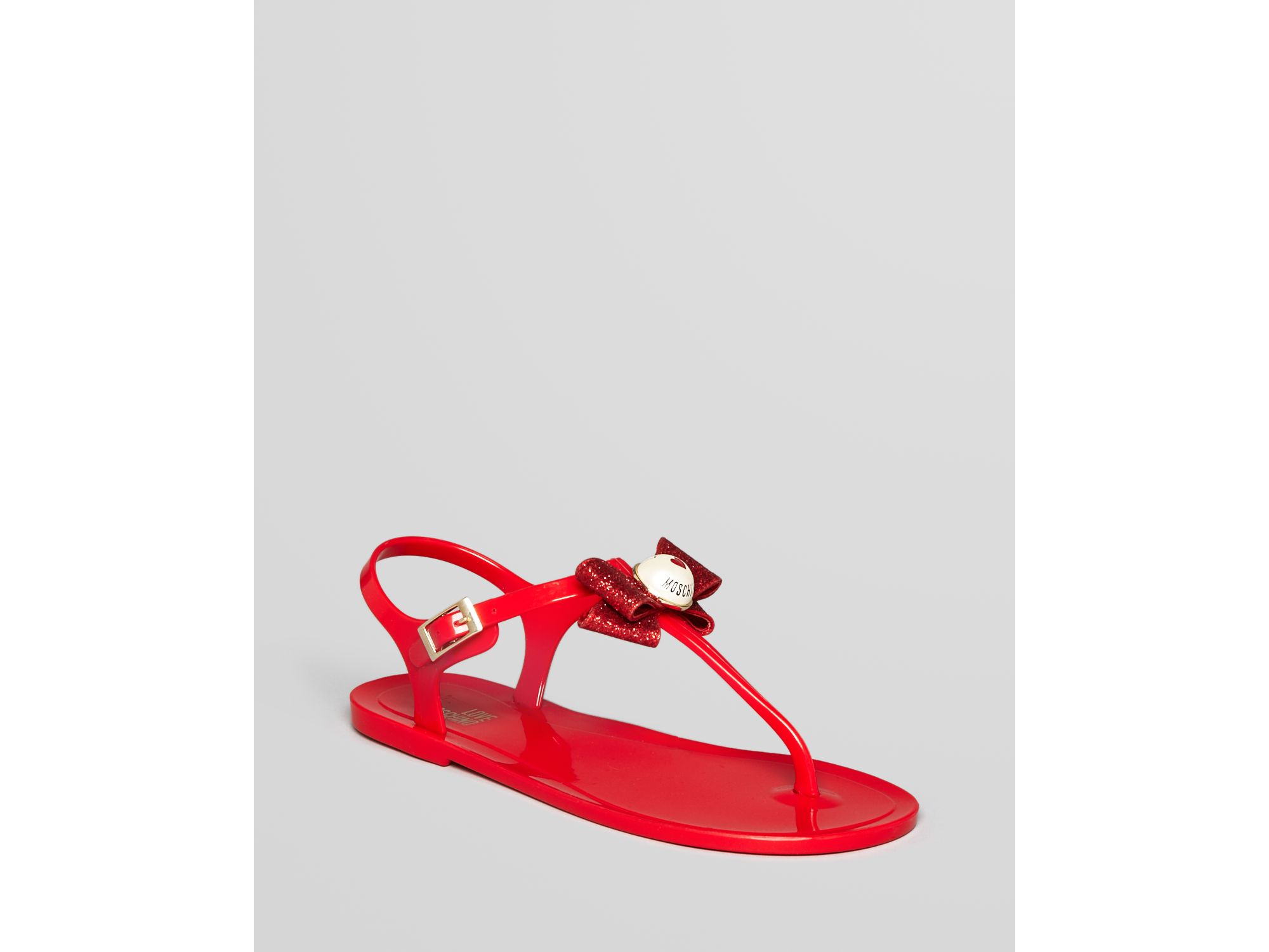 d02e99ef9315 Lyst - Love Moschino Thong Sandals Jelly Bow Flat in Red
