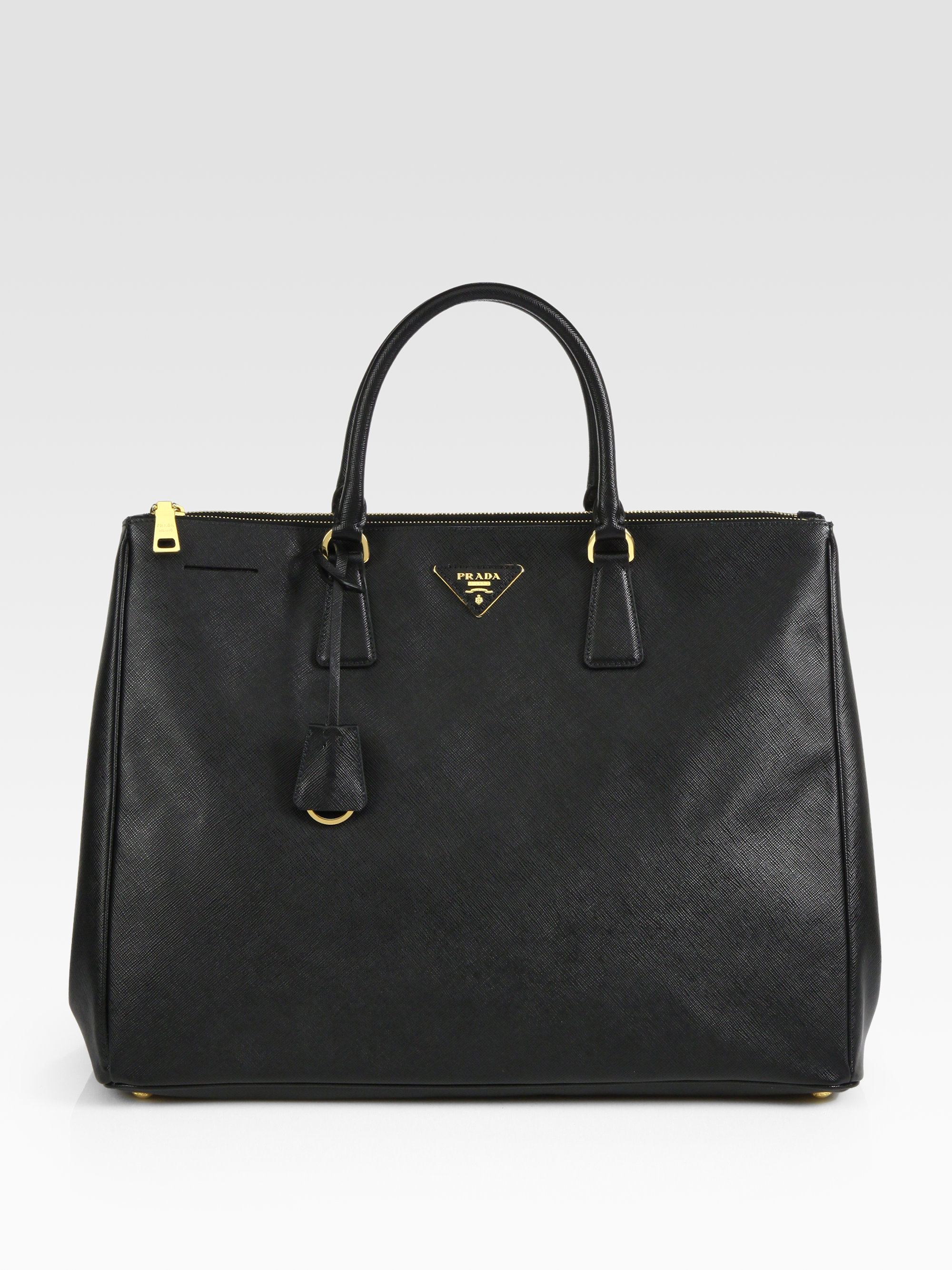 7a9a1b41bc85 ... coupon code lyst prada large saffiano top handle bag in black 1494c  47241