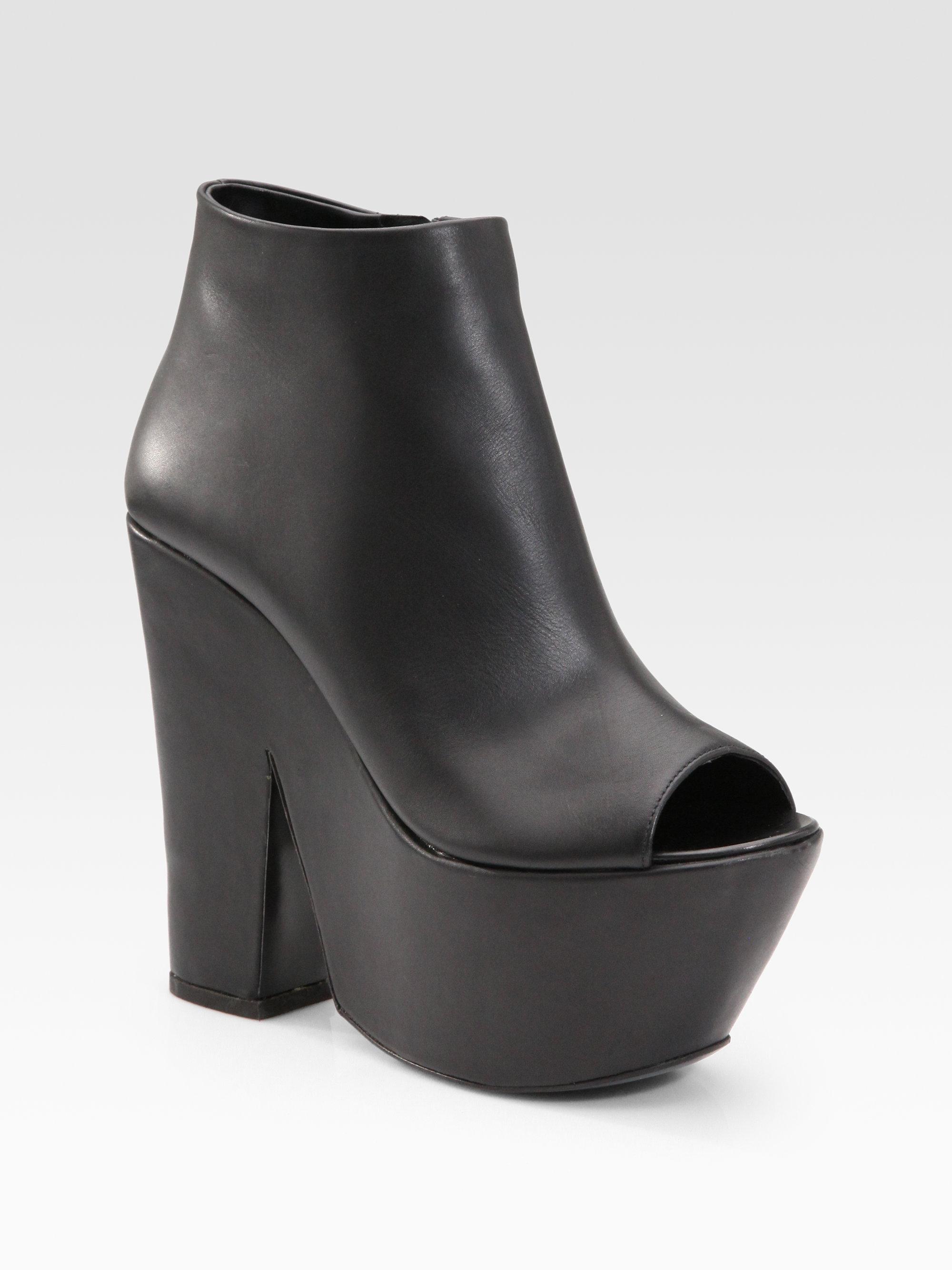 Lyst Giuseppe Zanotti Platform Peep Toe Ankle Boots In Black