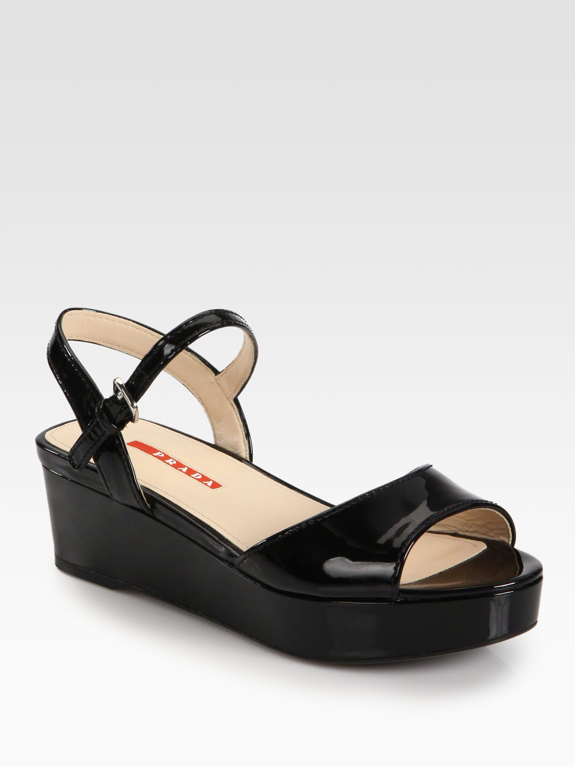 prada patent leather platform sandals in black nero black