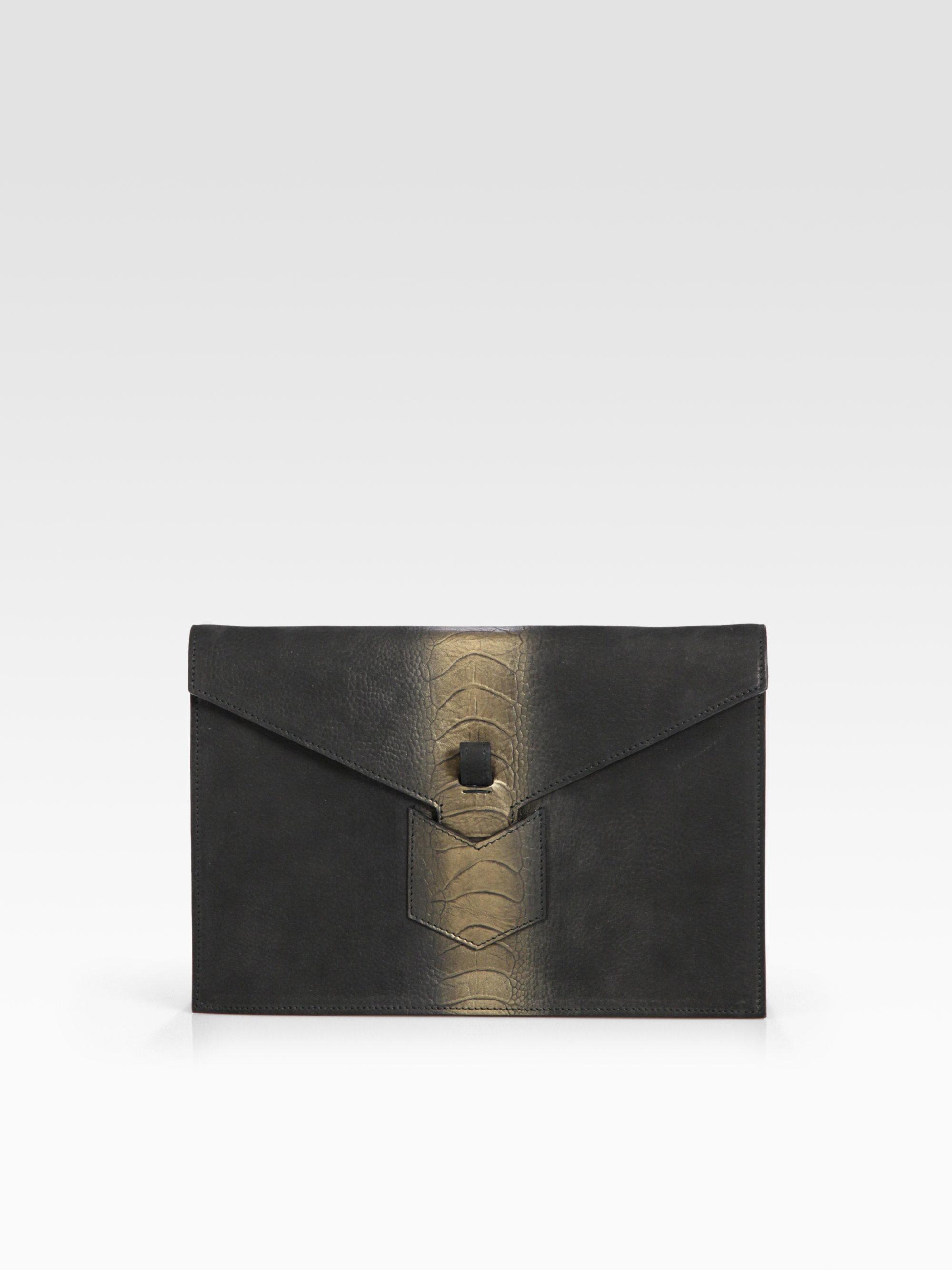 saint laurent classic monogram saint laurent tassel clutch in gold ...