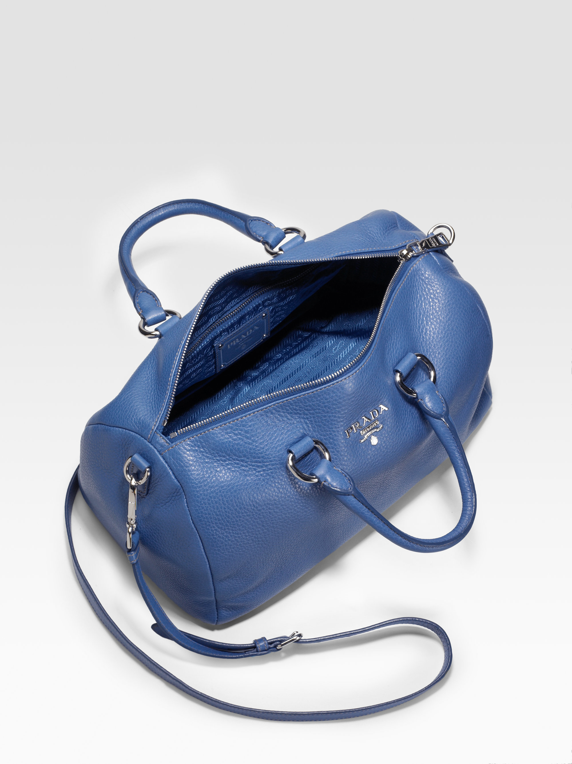 Prada Pebbled Leather Round Satchel in Blue (brown) | Lyst