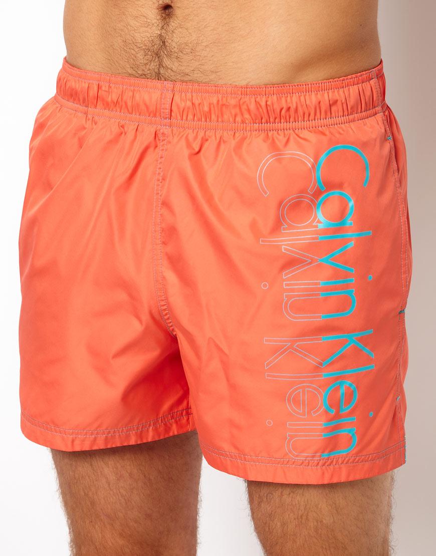ac76dce591 Calvin Klein Placement Logo Swim Shorts in Orange for Men - Lyst