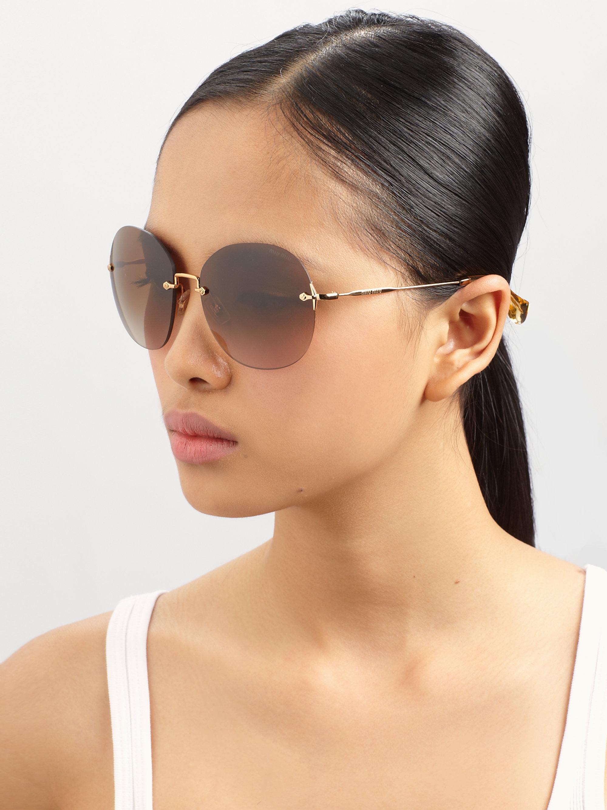 9dd352a757c4 Lyst - Miu Miu Round Metal Rimless Sunglasses in Gray