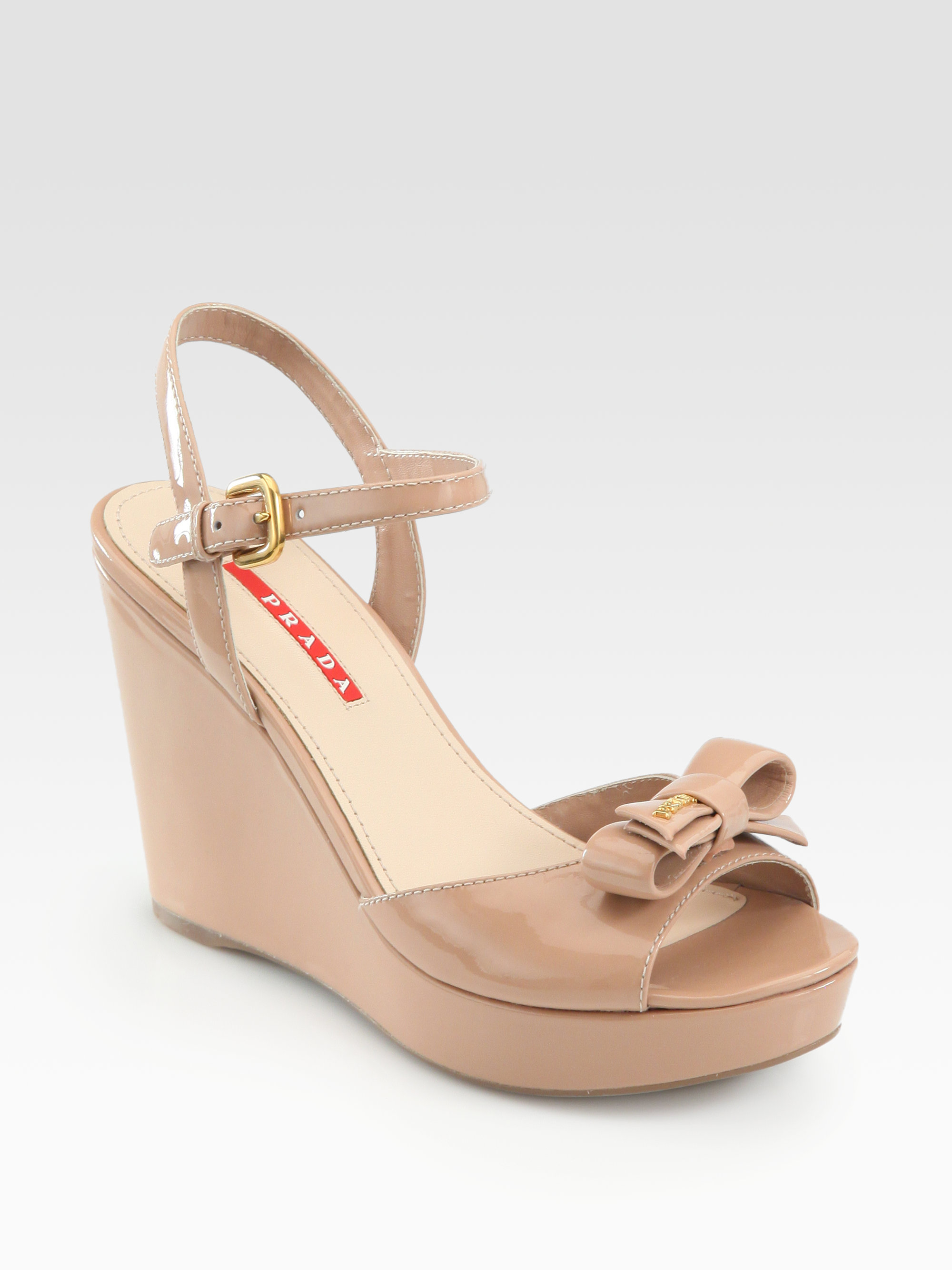 750936153c Prada Patent Leather Bow Wedge Sandals in Natural - Lyst