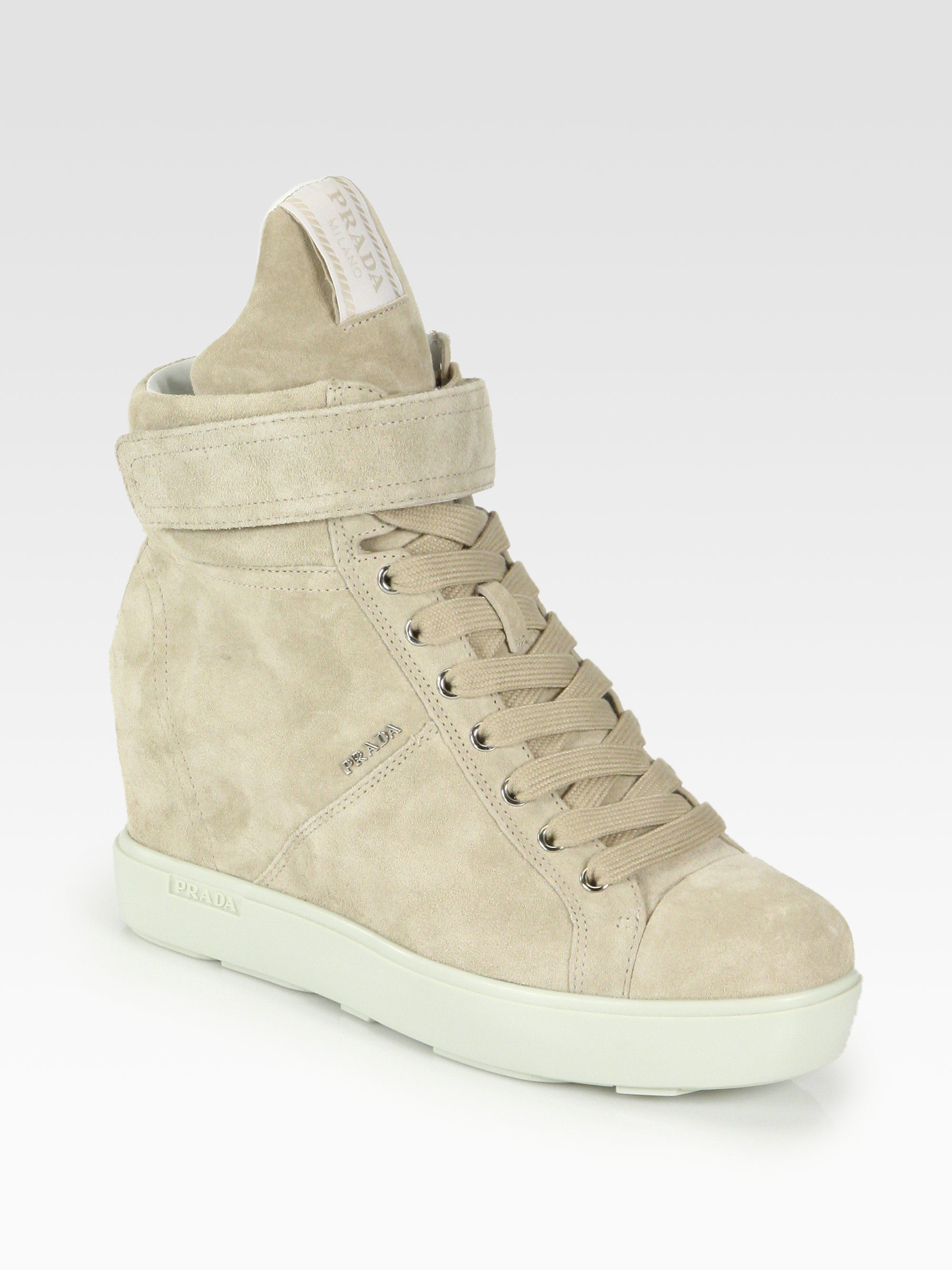 b9ecd069479 ... coupon code for lyst prada suede laceup wedge sneakers in natural 89e3a  3e2e4