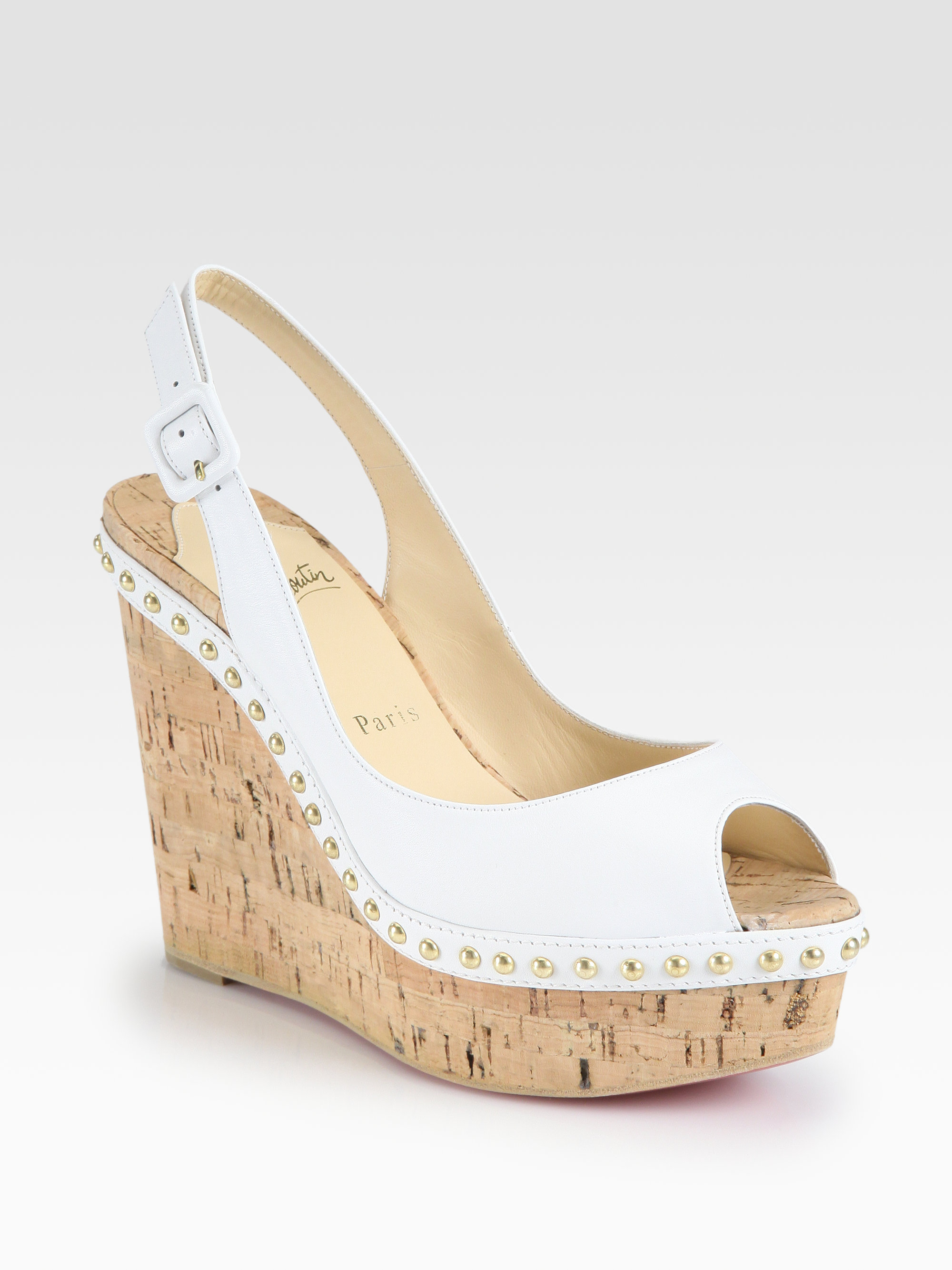 bca14490892 Lyst - Christian Louboutin Monico Studded Leather Cork Wedge Pumps ...