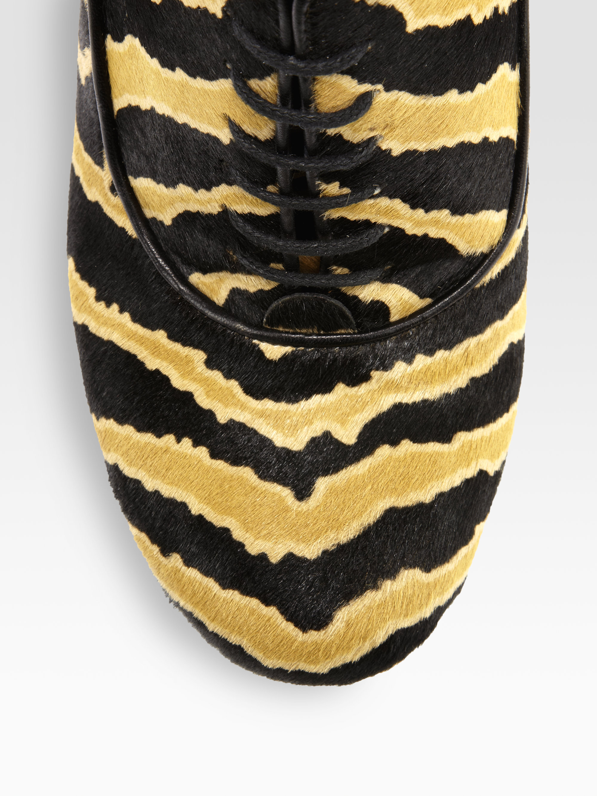 0c0eee2ee5 Gucci Animal print Pony Hair Laceup Ankle Boots in Yellow - Lyst