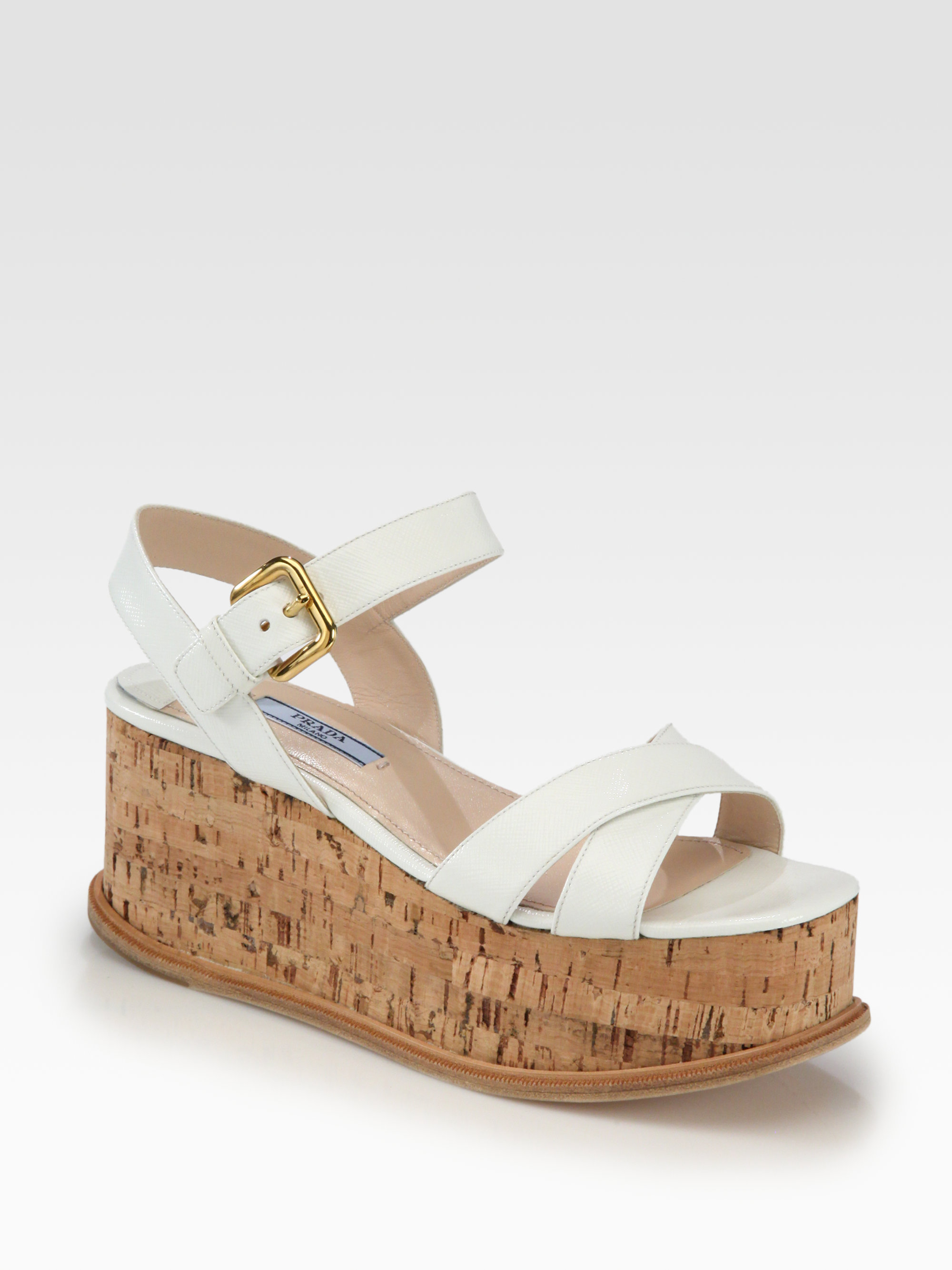 91e6edffeeb Lyst - Prada Saffiano Patent Leather Cork Wedge Sandals in White