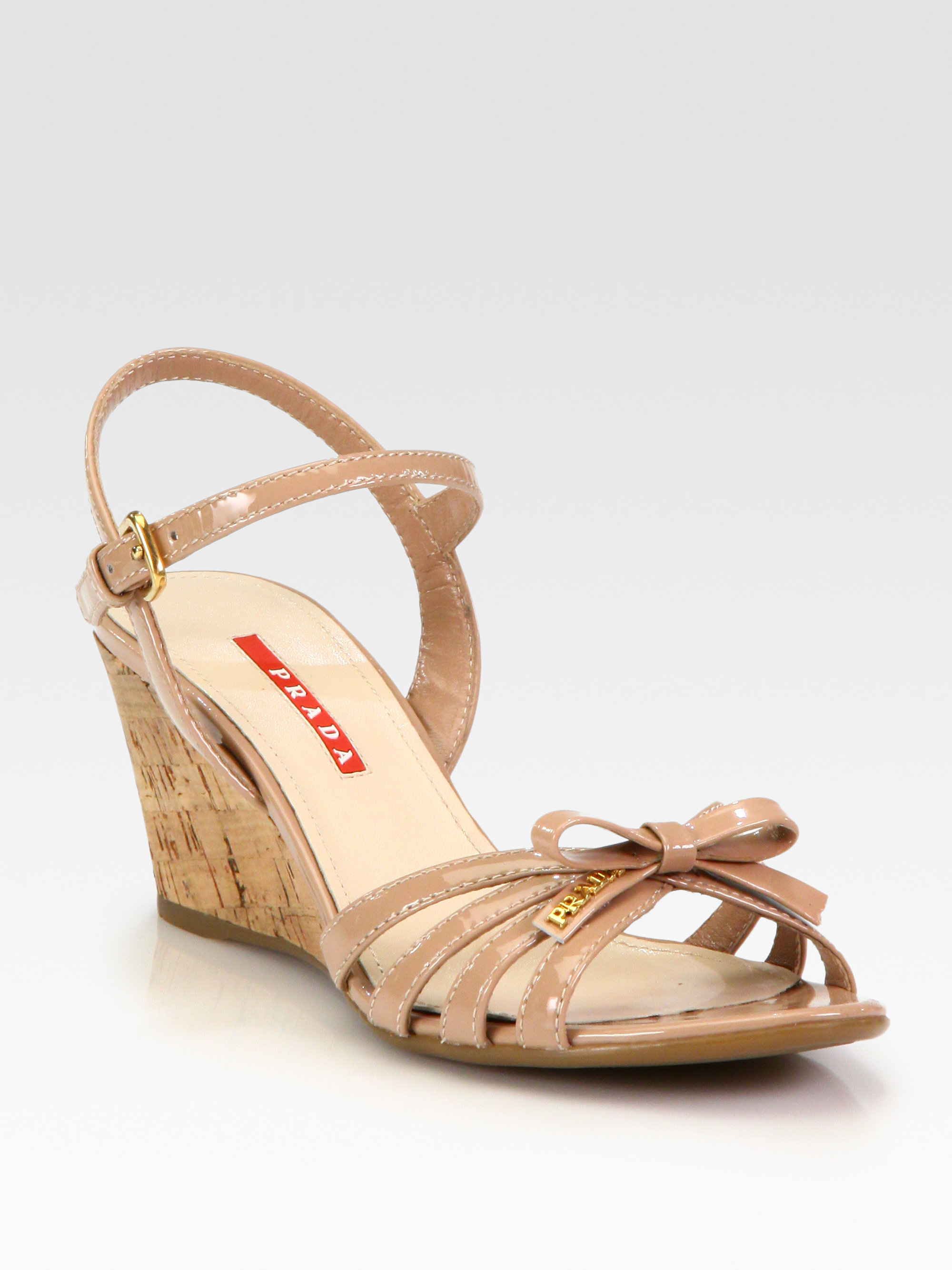 Lyst Prada Leather Bow Cork Wedge Sandals In Natural