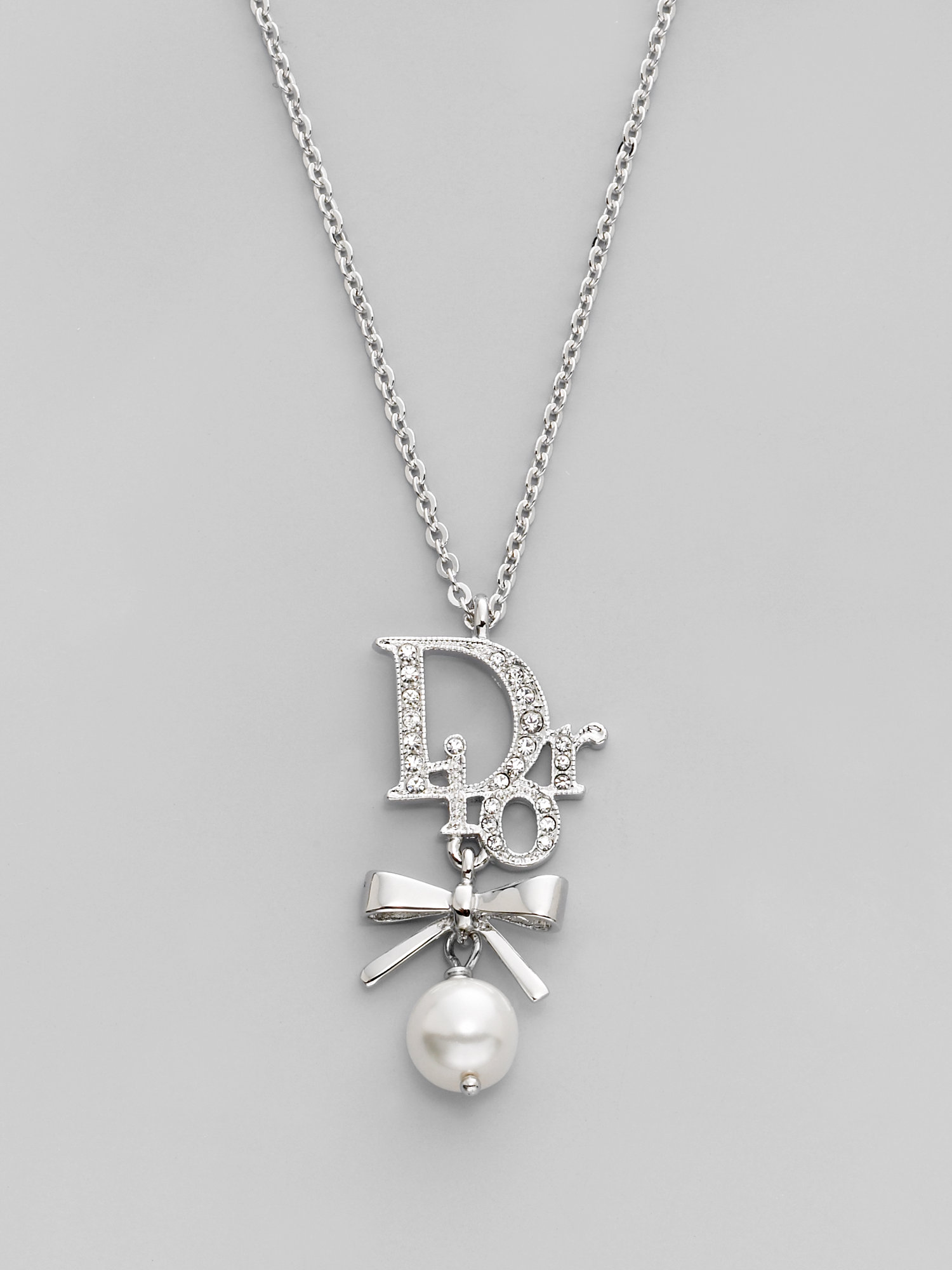 429810bd409ccb Dior Logo and Bow Necklace in Metallic - Lyst